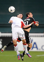 New England Revolution Blake Brettschneider (23) goes against D.C. United defender Daniel Woolard (21) D.C. United defeated The New England Revolution 3-2 at RFK Stadium, Saturday May 26, 2012.