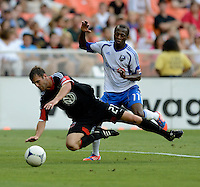 Daniel Woolard (21) of D.C. United is fouled from behind by Sanna Nyassi (11) of the Montreal Impact during the game at RFK Stadium in Washington DC.   D.C. United defeated the Montreal Impact, 3-0.