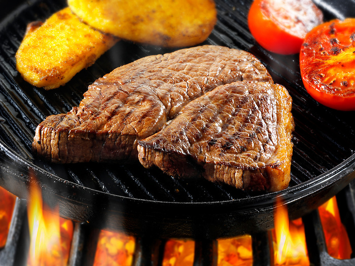 Beef rump steaks & pancetta being pan fried  on a bbq. Meat food photos, pictures & images.