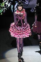 Annaleise walks runway in a Sugar, Sugar outfit, from the Betsey Johnson Fall 2011 He Loves Me Not - Black Tag collection, during Mercedes-Benz Fashion Week Fall 2011.