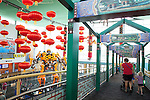 "Visitors enter The Children's Museum through gates inspired by their semi-permanent ""China: Take Me There"" exhibit, Indianapolis, Indiana, USA"