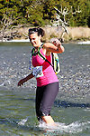 NELSON LAKES, NEW ZEALAND - APRIL 18:  Phaedra Robbins crosses the Travers River during the 2015 Alpine Lodge Loop The Lake trail run at Lake Rotoiti on April 18 16, 2015 in Nelson, New Zealand. (Photo by Marc Palmano/Shuttersport Limited)