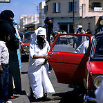 Woman getting in to car dressed in a burka, Cassablanca,Morocco 1975