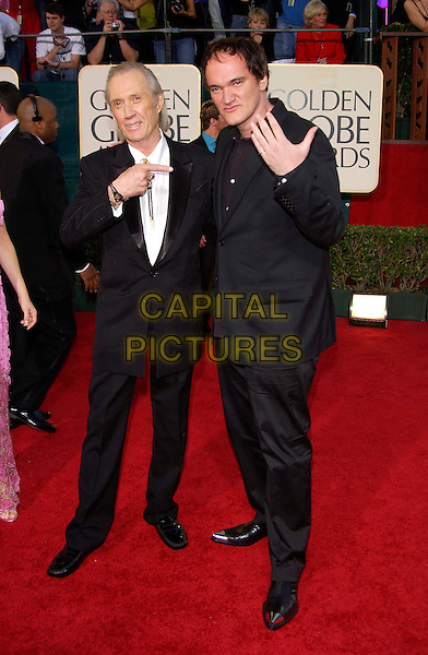 DAVID CARRADINE & QUENTIN TARANTINO.62nd Golden Globe Awards - Arrivals.Beverly Hills, Los Angeles, California..January 16th, 2004.full length, black suits, pointing, hand, gesture, steel tip toe shoes.www.capitalpictures.com.sales@capitalpictures.com.©Capital Pictures