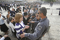 "Police man prevents from ultra orthodox woman to cross to a secure area due to ultra orthodox protest against the ""Women of the Wall"" at the Western Wall, Judaism's holiest site, in Jerusalem."