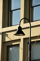 Curved metal  lighting fixture on the exterior of a building in Bellingham, Washington State, USA              .