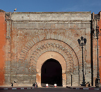 Bab Agnaou, one of nineteen gates of Marrakech, Morocco. Also called Gate of the Gnaoua after the sub-Saharan slaves who served the sultan, this stone structure was built in the 12th century during the Almohad dynasty. It enters onto the royal kasbah in the Southern medina. Koranic inscriptions in kufic script surround the horseshoe arch entrance. Picture by Manuel Cohen