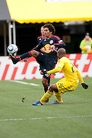 Mar 26, 2011; Columbus, OH, USA; New York Red Bulls midfielder Mehdi Ballouchy plays the ball over Columbus Crew defender Julius James  during their match at Columbus Crew Stadium. The game finished in a 0-0 tie.
