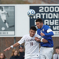 University of Connecticut midfielder Carlos Alvarez (10) and Creighton University defender Brendan Hines-Ike (6) battle for head ball. .NCAA Tournament. Creighton University (blue) defeated University of Connecticut (white), 1-0, at Morrone Stadium at University of Connecticut on December 2, 2012.