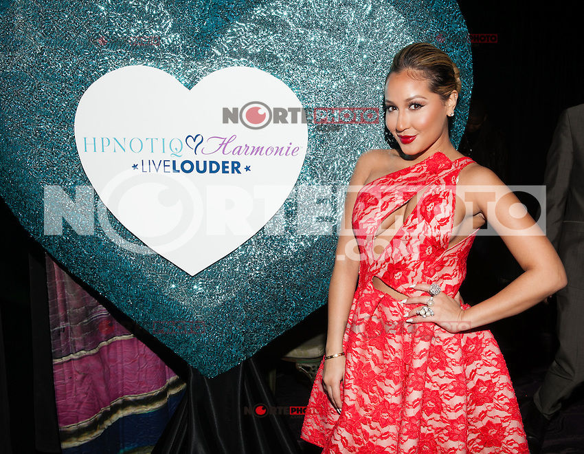 NEW YORK, NY - JANUARY 28: Adrienne Bailon celebrates the launch of her custom Valentine's Day cocktail recipe for HPNOTIQ liqueur on January 28, 2013 in New York City. © Diego Corredor/MediaPunch Inc. /NortePhoto /NortePhoto