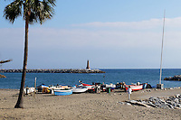Beach, boats, lighthouse, Mediterranean, Puerto Banus, Marbella, Spain, October, 2015. 201511121793<br /> <br /> Copyright Image from Victor Patterson, 54 Dorchester Park, Belfast, UK, BT9 6RJ<br /> <br /> t1: +44 28 9066 1296 (from Rep of Ireland 048 90661296)<br /> t2: +44 28 9002 2446 (from Rep of Ireland 048 90022446)<br /> m: +44 7802 353836<br /> <br /> e1: victorpatterson@me.com<br /> e2: victorpatterson@gmail.com<br /> <br /> www.victorpatterson.com<br /> <br /> IMPORTANT: Please see my Terms and Conditions of Use at www.victorpatterson.com