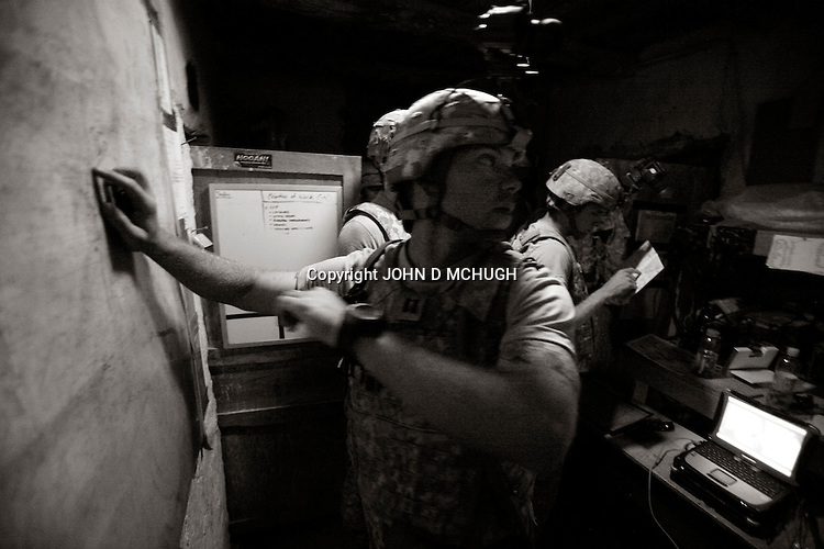 """US Captain McChrystal from Charlie Company, 1/503rd, 173rd Brigade gives orders during a """"Hostile Intent Fires"""" mission at Speray Combat Outpost in Khowst province, Afghanistan, 10 May 2008, after information was received that an insurgent attack was imminent. (John D McHugh)"""