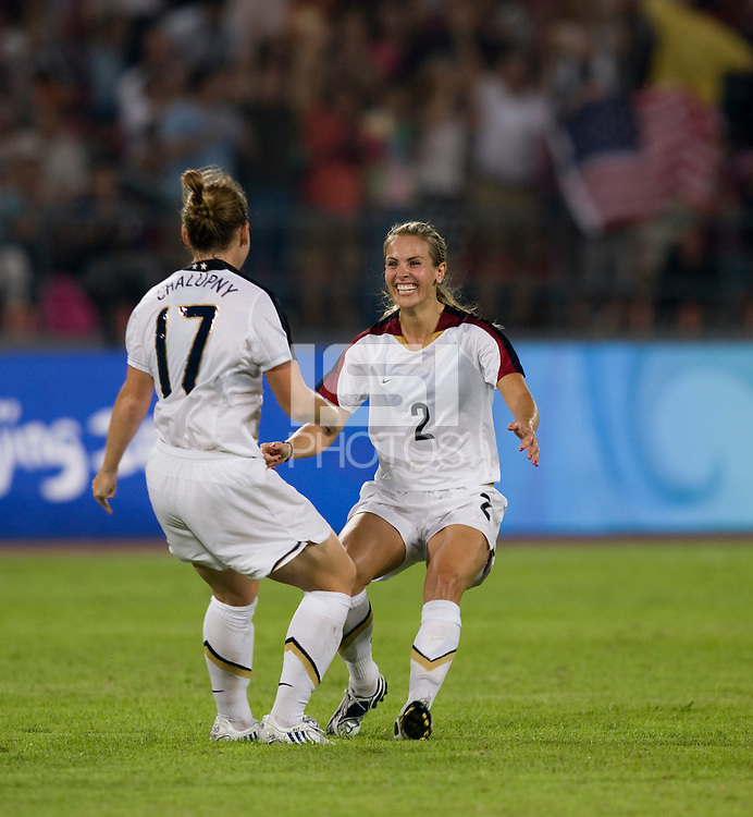 USWNT defender (17) Lori Chalupny celebrates her goal with teammate (2) Heather Mitts while playing at Worker's Stadium.  The USWNT defeated Japan, 4-2, during the semi-finals of the Beijing 2008 Olympics in Beijing, China.