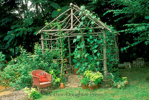 A unique  garden workstation and tool shed made of cut branches -- rustic and pleasing, Midwest USA