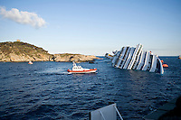 Island of Giglio, Italy, January 15, 2012.  The Costa Concordia cruise ship lies in the harbor of the Tuscan island of Giglio after it ran aground after hitting underwater rocks.