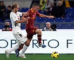 Calcio, Serie A: AS Roma vs Torino. Roma, stadio Olimpico, 19 novembre 2012..AS Roma midfielder Alessandro Florenzi is challenged by Torino midfielder Migjen Basha, of Switzerland, left, during the Italian Serie A football match between AS Roma and Torino at Rome's Olympic stadium, 19 November 2012..UPDATE IMAGES PRESS/Isabella Bonotto