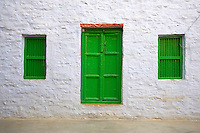 """The Green windows and door Jaisalmer the old City and fort.J a i s a l m e r   J a i s a l m e r  n i c k n a m e d   """" T h e   G o l d e n   C i t y """" ,   i s   a   t o w n   i n   t h e   I n d i a n   s t a t e   o f   R a j a s t h a n .   T h e   t o w n   s t a n d s   o n   a   r i d g e   o f   y e l l o w i s h   s a n d s t o n e ,   c r o w n e d   b y   a   f o r t ,   w h i c h   c o n t a i n s   t h e   p a l a c e   a n d   s e v e r a l   o r n a t e   J a i n   t e m p l e s .   M a n y   o f   t h e   h o u s e s   a n d   t e m p l e s   a r e   f i n e l y   s c u l p t u r e d .   I t   l i e s   i n   t h e   h e a r t   o f   t h e   T h a r   D e s e r t   a n d   h a s   a   p o p u l a t i o n   o f   a b o u t   7 8 , 0 0 0 .   I t   i s   t h e   a d m i n i s t r a t i v e   h e a d q u a r t e r s   o f   J a i s a l m e r   D i s t r i c t ....Jaisalmer Fort is one of the largest of desert forts of the world. It is situated in Jaisalmer city in Indian state of Rajasthan. It was built in 1156 AD by the Bhati Rajput ruler Rawal Jaisal, from where it derives it name. The fort stands proudly admist the golden stretches of the great Thar Desert, on Trikuta Hill and had been the scene of many battles. Its massive yellow sandstone walls are a tawny lion color during the day, turning to a magical honey-gold as the sun sets and camouflages the fort making it appear a part of the picturesque yellow desert. Thus, it is also known as the """"Golden Fort"""".."""