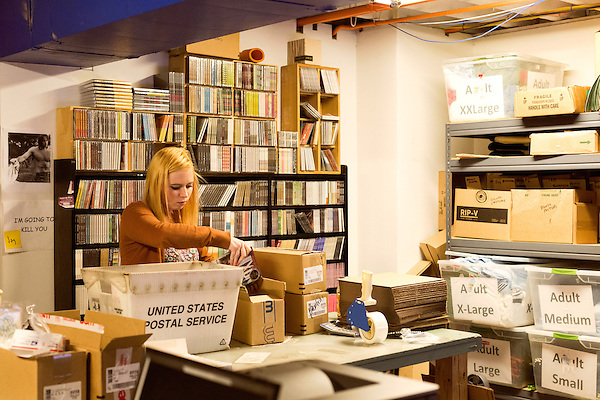 March 20, 2014. Durham, North Carolina.<br />   Intern Bri Aab boxes cd's for shipping at MERGE HQ in downtown Durham.