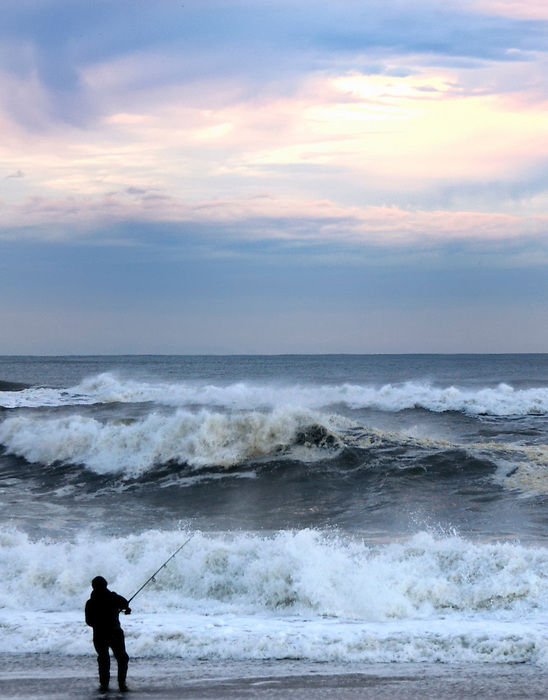 Fisherman at Dawn on the Great South Bay at Fire Island as the Sun Breaks Through the Clouds
