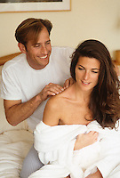 Woman receiving a Playful massage by a man