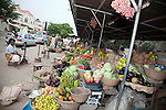 Women sell fruits and vegetables at the &quot;Les Cocotier&quot; market in Cotonou, Benin.