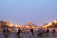 bicycles, motorbikes and cars on Xichang'an street between the forbiden city and tian'anmen square, long exposure