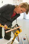 Plumbing student using a pipe bender, Able Skills, Dartford, Kent.