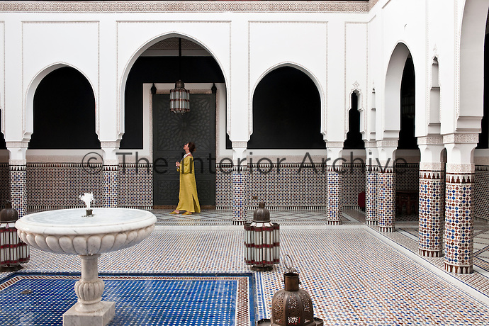 A guest walking through the inner courtyard