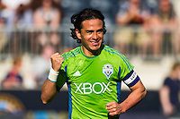 Seattle Sounders Mauro Rosales (10) celebrates scoring. The Philadelphia Union and the Seattle Sounders played to a 2-2 tie during a Major League Soccer (MLS) match at PPL Park in Chester, PA, on May 4, 2013.