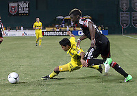 WASHINGTON, DC - AUGUST 4, 2012:  Brandon McDonald (4) of DC United tries to get to the ball past Jairo Arrieta (25) of the Columbus Crew during an MLS match at RFK Stadium in Washington DC on August 4. United won 1-0.