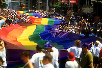 Giant one mile long Rainbow Flag is unfurled on First Ave. in New York City during the celebration and Gay Pride Day-Stonewall 25 Parade on June 26, 1994. (© Frances M. Roberts)