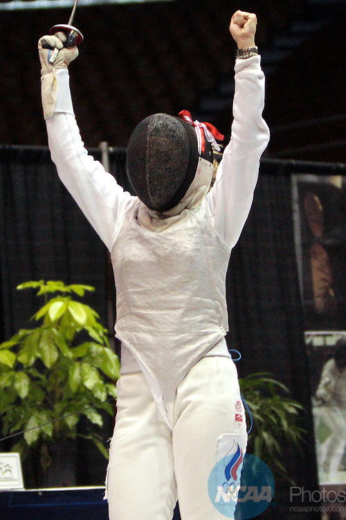 23 MAR 2012:  Evgeniya Kirpicheva celebrates scoring against Luona Wang of Penn in the foil competition of the Division I Women's Fencing Championship held at St. John Arena on the Ohio State University campus in Columbus, OH. Kirpicheva defeated Wang 15-8 to claim the national title.  Jay LaPrete/ NCAA Photos