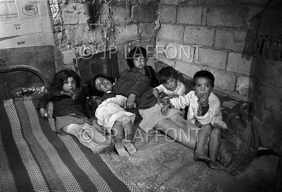 Bogota, Colombia - The Gamines are abandoned kids at the age of 5 - 10 living in the streets of Bogota. They are robbers, beggers and addicted to sniffing gazoline. At night they all sleep together in city sewers. Child labor as seen around the world between 1979 and 1980 – Photographer Jean Pierre Laffont, touched by the suffering of child workers, chronicled their plight in 12 countries over the course of one year.  Laffont was awarded The World Press Award and Madeline Ross Award among many others for his work.