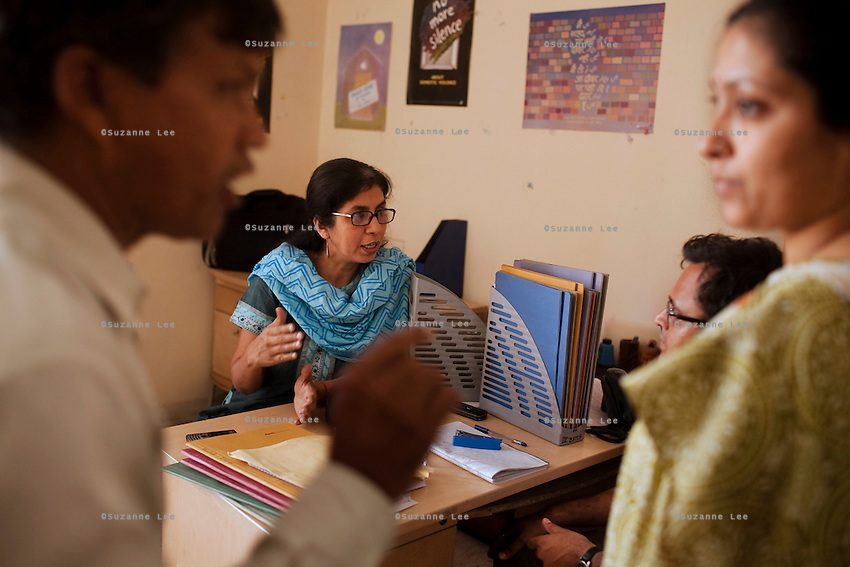 Meenu Vadera (center, in blue) talks with students and staff on 30th March 2010 in Azad Foundation.<br /> Currently training their 4th batch of students, Azad Foundation was set up by Meenu Vadera (Executive Director) in New Delhi, India, to train Indian women in driving services. Upon completion, these women work as personal drivers for a period of time before they upgrade their driving licences to commercial licences, allowing them to drive taxis. With this program, Azad aims to empower Indian women including those previously abused or trafficked, while making Delhi a safer place for women travelling in public transport. Photo by Suzanne Lee for Panos London
