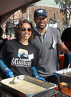 Los Angeles, CA - NOVEMBER 23: Gloria Govan, Derek Fisher, At Los Angeles Mission Thanksgiving Meal For The Homeless At Los Angeles Mission, California on November 23, 2016. Credit: Faye Sadou/MediaPunch