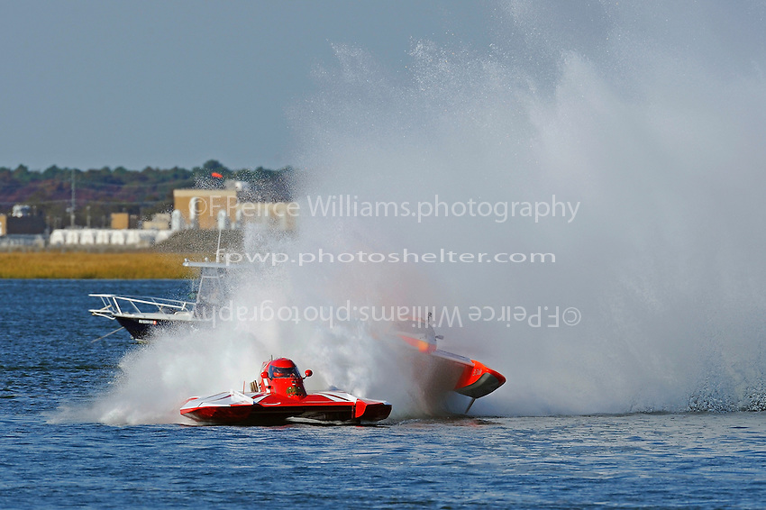 """Frame 7: Joe Less, E-500 """"Cents Less 14"""" and CE-666 """"El Diablo race into the second turn on the first lap, CE-666 slides out and rides the roostertail of E-14 up and over before falling back to the water right side up."""