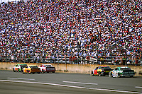 DAYTONA BEACH, FL - FEBRUARY 14: Dale Jarrett, driving the Interstate Batteries Chevrolet Lumina, leads a group of cars past the grandstand toward the tri-oval en route to winning the Daytona 500 NASCAR Winston Cup race at the Daytona International Speedway in Daytona Beach, Florida, on February 14, 1993.