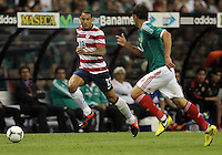 MEXICO CITY, MEXICO - AUGUST 15, 2012:  Jermaine Jones (13) of the USA MNT moves past Hector Moreno (15) of  Mexico during an international friendly match at Azteca Stadium, in Mexico City, Mexico on August 15. USA won 1-0.