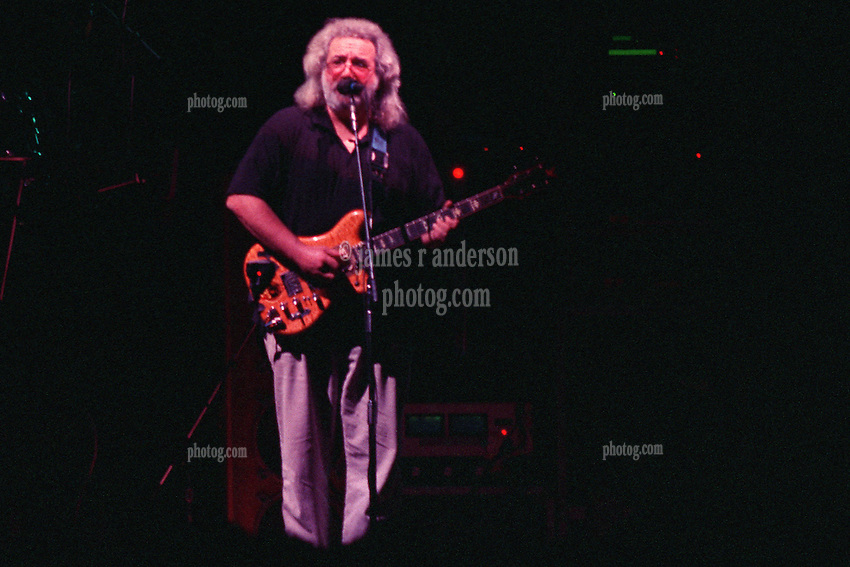 """Jerry Garcia performing with The Grateful Dead Live at The Hampton Coliseum on 9 October 1989. One of the Eleven images included in the CD boxed set release, """"Formerly The Warlocks"""". Image capture during """"Dark Star"""". Can be purchased individually or as part of a special limited set of all 11 in the package printed by the photographer. Choose in Cart."""