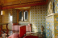 A patterned and colourful anteroom is decorated with floor and wall tiles and has a hand-painted ceiling