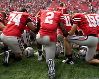 September 27, 2008: Ohio State quarterback Terrelle Pryor (2) kneels for a post-game prayer. The Ohio State Buckeyes defeated the Minnesota Gophers 34-21 on September 27, 2008 at Ohio Stadium, Columbus, Ohio.