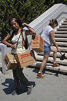 Israelis carry boxes with gas masks at a distribution center in Tel Aviv on August 28, 2013. As talks of an international attack on Syria heighten, the demand for gas masks in Israel rose.   Photo by Oren Nahshon
