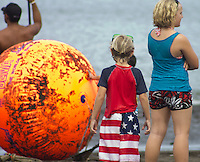 Colorful swim attire and orange float at the standup competition in Hilo, an annual standup board competition in Hawaii