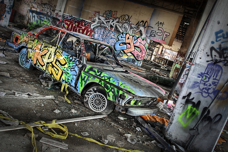 An old BMW car with graffiti