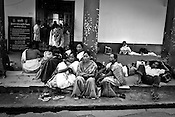Patients and their family members wait out the district hospital of Dibrugarh in Assam, India. Photo: Sanjit Das