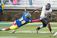 Newark, DE - October 29, 2016: Towson Tigers running back Deshaun Wethington (4) stiff arms Delaware Fightin Blue Hens linebacker Jalen Kindle (34) during game between Towson and Delware at  Delaware Stadium in Newark, DE.  (Photo by Elliott Brown/Media Images International)