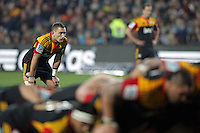 Chiefs' Aaron Cruden catches his breath whilst a scrum gets under way against the Crusaders in a Super Rugby match, Waikato Stadium, Hamilton, New Zealand, Friday, July 06, 2012.  Credit:SNPA / David Rowland
