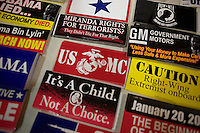 Conservative- and military-themed bumper stickers lay on a table for sale at the Hillsborough County Republican Gala at the Crowne Plaza Hotel in Nashua, New Hampshire, on Jan. 6, 2012. Former congressmen Rick Santorum and Newt Gingrich spoke at the event. Both are seeking the 2012 Republican presidential nomination.