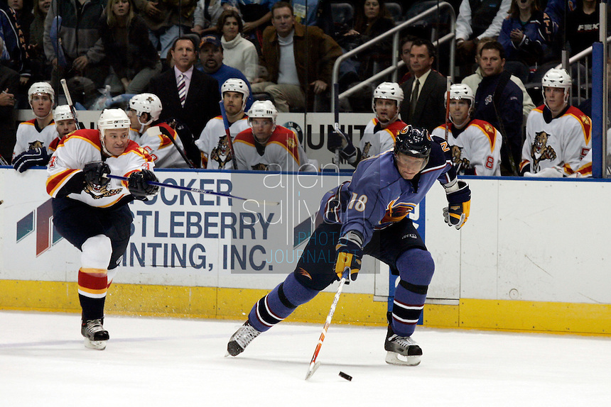 Atlanta Thrashers right wing Marian Hossa handles the puck as Florida Panthers defenseman Jay Bouwmeester follows in the third period at Philips Arena. The Thrashers won the game 1-0.<br />