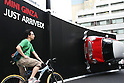 May 14, 2010 - Tokyo, Japan - A man stands near a life size model of a Mini Cooper on display outside MINI Ginza, the MINI's 100th showroom in Japan, on May 14, 2010. Opened on May 12 in Tokyo, this showroom will be a center for new MINI products and lifestyle events, with regular events and activities according to the car maker.